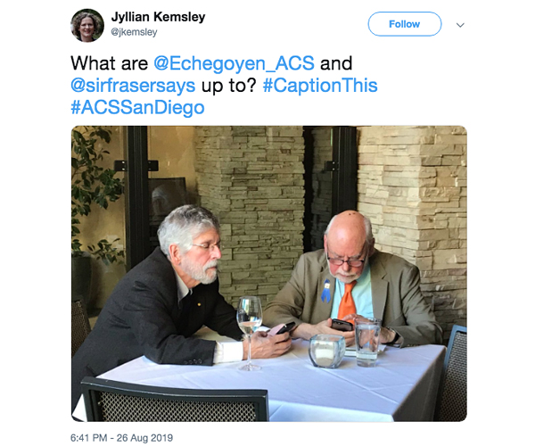A tweet about two men at a table.